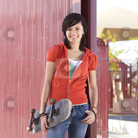 Teen skater girl stock photo, Teen girl with skateboard hangs out at the park by Rick Becker-Leckrone
