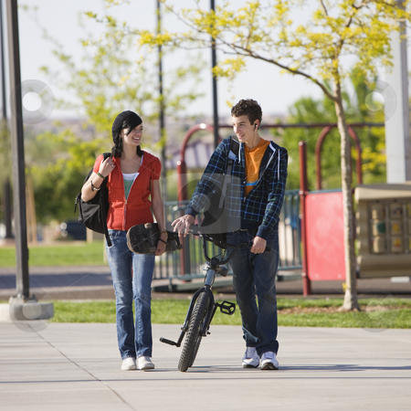 Teens couple walks stock photo, Two kids walk home by Rick Becker-Leckrone
