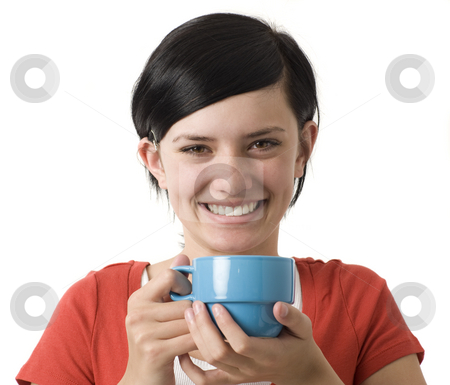 Girl with cup smiles stock photo, A girl in a red shirt holds a blue cup and smiles by Rick Becker-Leckrone