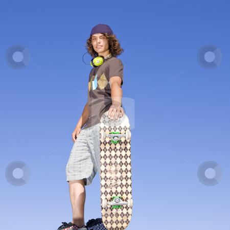 Teen skater atop ramp stock photo, Teen skater atop ramp by Rick Becker-Leckrone