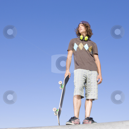 Teen skater atop ramp stock photo, Skater at park by Rick Becker-Leckrone