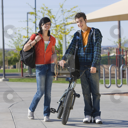 Teen couple at park stock photo, Two kids walk home through a park by Rick Becker-Leckrone