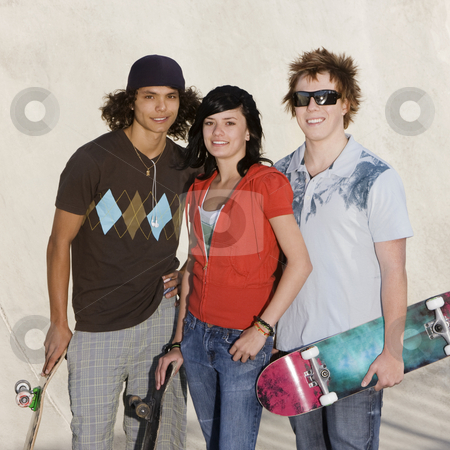 Teens at the skatepark stock photo, Two kids hang out at the skate park by Rick Becker-Leckrone