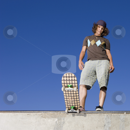 Skater at halfpipe stock photo, Skateboarder at top of half pipe by Rick Becker-Leckrone