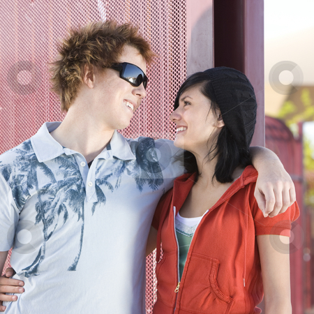 Teen skater couple stock photo, Teen skating couple hangs out at the park by Rick Becker-Leckrone