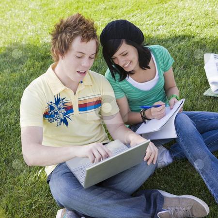 Teen couple do homework stock photo, Teen couple do homework in the grass by Rick Becker-Leckrone