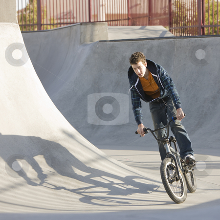 Biking at skatepark stock photo, Biking at skatepark by Rick Becker-Leckrone