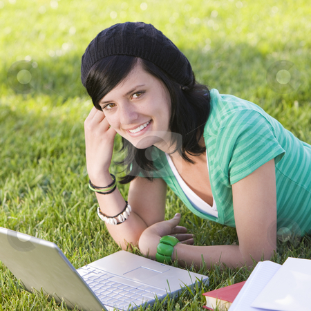 Happy teen in car stock photo, Teen studies with laptop in grass and smiles by Rick Becker-Leckrone
