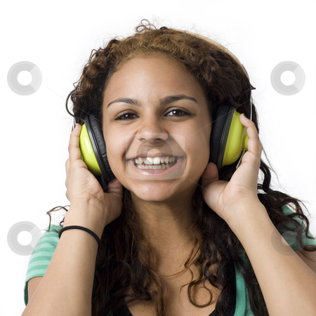 Girl with green headphones stock photo, A girl listens to music with green headphones by Rick Becker-Leckrone
