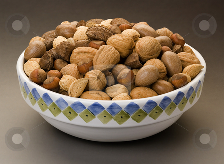 Bowl of Mixed Nuts stock photo, Bowl of Mixed Nuts isolated on a dark background by Danny Smythe