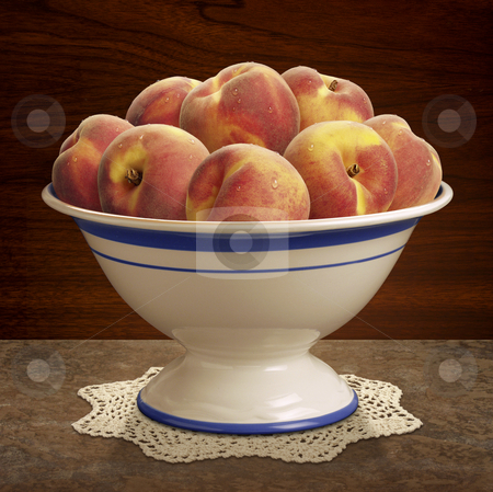 Bowl of Peaches stock photo, Bowl of Peaches on table with a wood wall by Danny Smythe