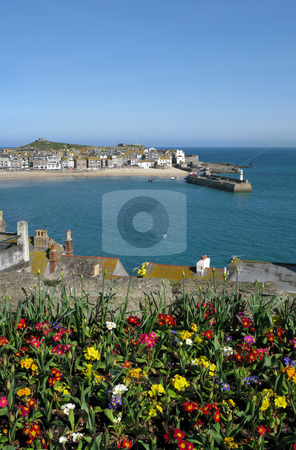 St. Ives harbour with colourful spring flowers in the foreground. stock photo, St. Ives harbour with colourful spring flowers in the foreground. by Stephen Rees