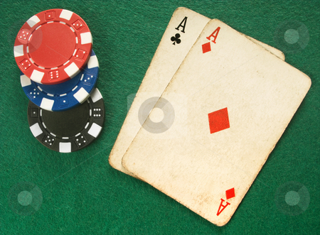 Two vintage aces and poker chips. stock photo, Two vintage aces and poker chips. by Stephen Rees