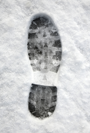 Close up of a footprint in the snow. stock photo, Close up of a footprint in the snow. by Stephen Rees