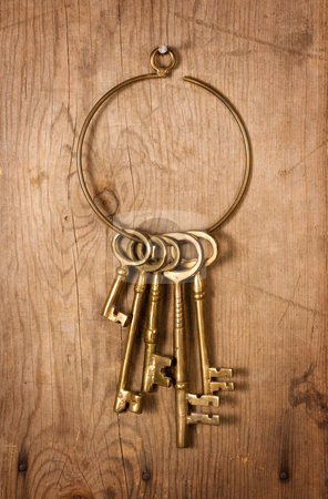 Old Brass Keys stock photo, Old Brass Keys on old wood with nails by Danny Smythe