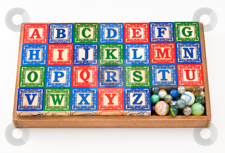 Box of Toy Blocks stock photo, Box of Toy Blocks isolated on a white background by Danny Smythe