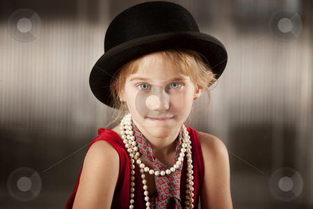 Girl with bowler hat stock photo, Funny young girl wearing a bowler hat by Scott Griessel