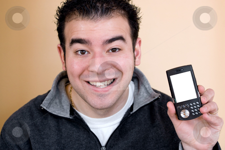 Cell Phone with Clipping Path stock photo, A happy young man showing the screen of a smartphone.  The white cell phone screen includes the clipping path. by Todd Arena