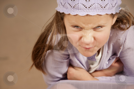 Angry young girl stock photo, Angry young girl wearing a purple knit cap by Scott Griessel