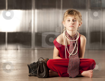 Cute young girl in red  stock photo, Cute young girl with big eyes in dress-up clothes by Scott Griessel