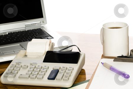 Isolated Office Desk stock photo, An office desk with a cup of coffee, a calculator and a laptop, isolated against a white background by Richard Nelson