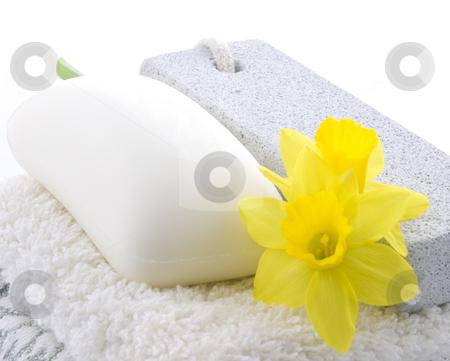 Daffodil, soap, pumice and towel stock photo, Daffodil, soap, pumice and towel on white background by John Teeter