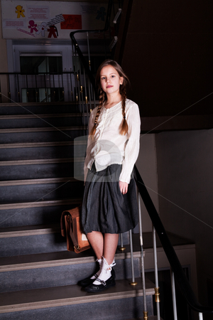 Lovely girl on the stairs stock photo, Young girl on school with a old school outfit by Frenk and Danielle Kaufmann