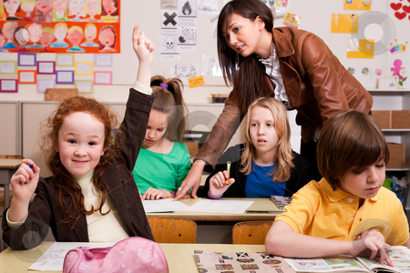 I have a question stock photo, Group of little students with different ages in a classroom by Frenk and Danielle Kaufmann