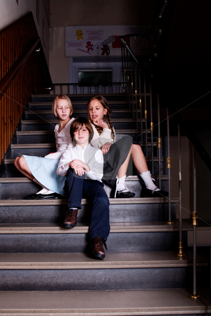 Kids sitting on the stairs stock photo, Group of little students with different ageson the stairs by Frenk and Danielle Kaufmann