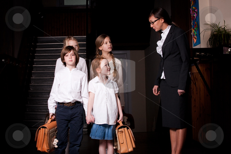 Listening to our teacher stock photo, Group of little students with different ageson the stairs by Frenk and Danielle Kaufmann