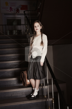 Sweet girl on the stairs stock photo, Young girl on school with a old school outfit by Frenk and Danielle Kaufmann