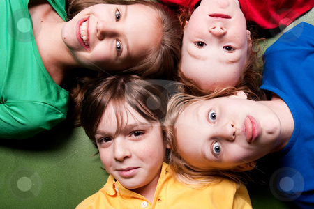 Happy color schoolkids stock photo, Group of little students with different ages in a happy mood by Frenk and Danielle Kaufmann