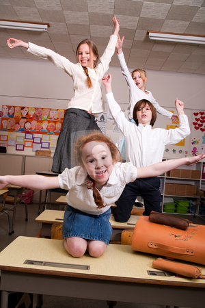 Flying in the classroom stock photo, Group of little students with different ages in a classroom by Frenk and Danielle Kaufmann