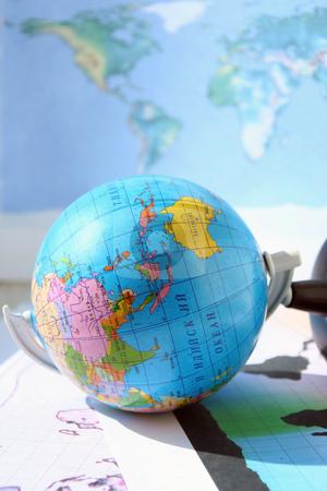 Geographical card stock photo, The globe lies on a world card by Aleksandr GAvrilov