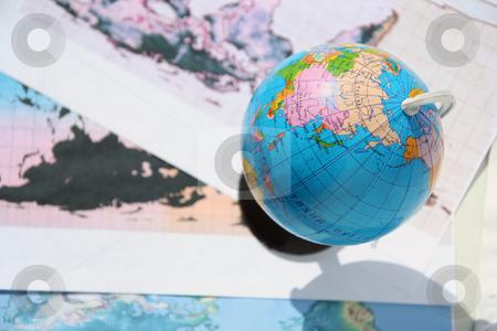 globe and world card stock photo, The globe lies on a world card by Aleksandr GAvrilov