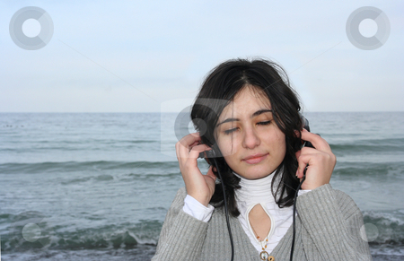 Sea voice stock photo, The girl has closed eyes and hears the sea by Aleksandr GAvrilov