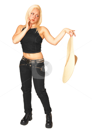 Standing woman in black jeans. stock photo, A young pretty woman standing in black jeans having fun, for white background and looking at her straw hat.. by Horst Petzold