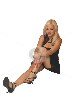 Beautiful blond girl. stock photo, Lovely lady in black miniskirt and high heels, long blond hair, sitting on the floor in a studio. by Horst Petzold
