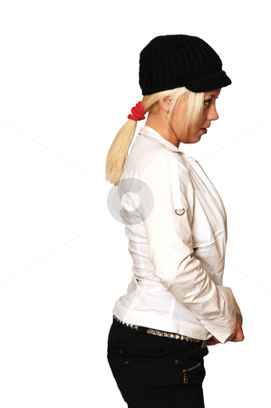 Portrait of young girl. stock photo, Side portrait of a young blond girl with an black cap and with jacket. by Horst Petzold