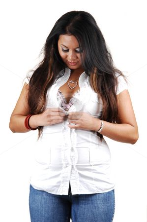 A asian woman undoing her blouse. stock photo, A beautiful young asian woman undoing her white blouse to shoe the the nice bra and the black hair hanging down. by Horst Petzold