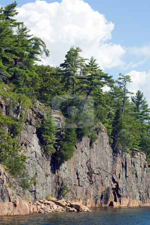 Cliff stock photo, High rock cliff above Horon lake by Pavel Cheiko