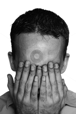 Isolated Depressed Man stock photo, Closeup view of a young man suffering from depression and covering his eyes, done in black and white by Richard Nelson