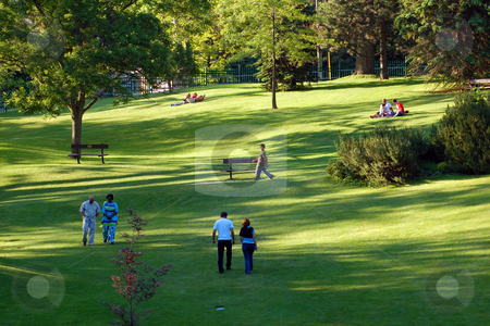 Park stock photo, Landscape - People on green grass lawn in park by Pavel Cheiko