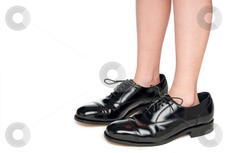 A young child in black leather formal business shoes stock photo, A young child in black leather formal business shoes by Vince Clements
