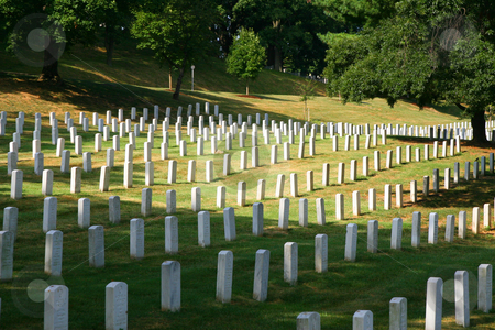 Cemetery stock photo, Peaceful view of headstones at historic Arlington National Cemetery in washington DC by Maria OBrien
