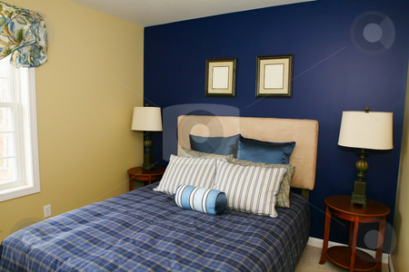 Comfortable Bedroom stock photo, Comfortable bed with pillows in blues and beige by Maria OBrien