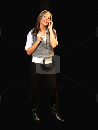 Young lady in tights. stock photo, An young lady in tights white blouse standing for black background and speaking on the cell phone. by Horst Petzold