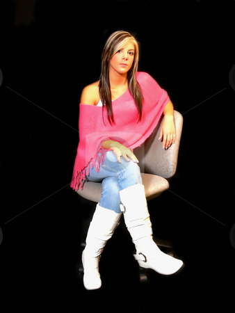Portrait of young lady. stock photo, An portrait of a beautiful young blond lady wearing a pink top and  jeans with white boots in front of black background. by Horst Petzold