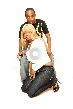 Young black couple. stock photo, African American couple kneeling in an studio for white background. by Horst Petzold