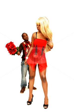 Young black couple. stock photo, A young African American couple standing in the studio and the gay is trying  to get her attention. by Horst Petzold